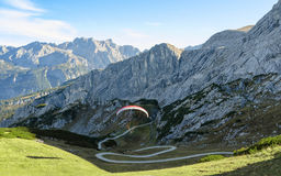 Flying paraglider in Bavarian Alps. Alpine landscape with free soaring paraglider in Bavarian Alps mountains Royalty Free Stock Photography