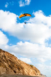 Flying paraglider Stock Images