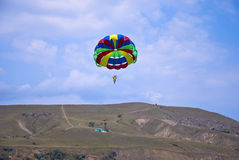 Flying paraglider in the mountain Stock Photography