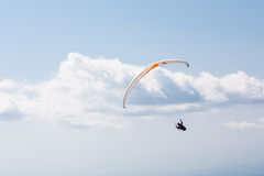Flying paraglider in the sky. Paragliding over the mountain against blue sky Royalty Free Stock Photo