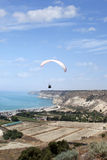 Flying paraglider in the sky,  Kourion, Cyprus Royalty Free Stock Photos
