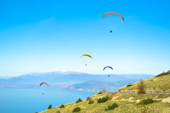 Flying paragliders Stock Photo