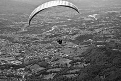 Flying with paragliders over Belluno stock photos