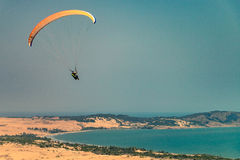Flying paragliders Stock Image