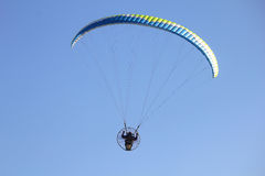 Flying paragliders in the sky. A flying paragliders in the sky Stock Photo