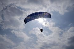 Flying paragliding with sky and clouds Stock Photos