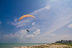 Flying paramotor under blue sky Stock Images