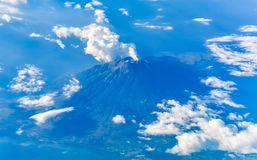 Flying past a volcano. Somewhere over Asia on a Scoot Airways Sydney to Singapore Flight Royalty Free Stock Photos