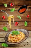 Flying Pasta with Marinara sauce and fresh Basil Royalty Free Stock Photos