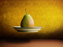 Flying pear on a plate Stock Image
