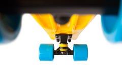 Flying penny skateboard, bottom view on white Stock Images