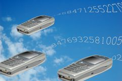 Flying phones. Flying mobile phones Royalty Free Stock Photography