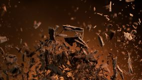 Free Flying Pieces Of Crushed Chocolate Pieces Royalty Free Stock Photography - 163579467