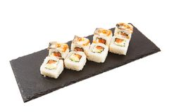 Flying pieces of sushi with wooden chopsticks, separated on white background. Flying food and motion concept. Sushi isolated on royalty free stock image