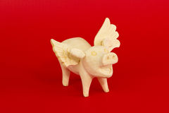 Flying pig. Mexican wood craft of pig with wings Stock Images
