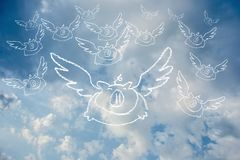 Flying Pig Doodle on blackboard on sky with clouds.  Stock Photo