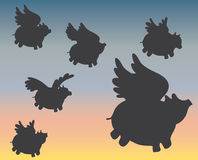 Flying pig silhouettes. Silhouettes of pigs flying through evening sky Royalty Free Stock Photo