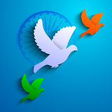 Flying pigeon in Indian Flag color on blue background. Royalty Free Stock Photos