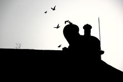 Flying Pigeons passing the ridge of Chinese palace Royalty Free Stock Photo