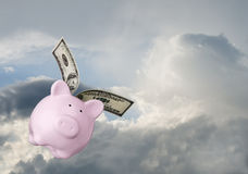 Flying piggy bank Royalty Free Stock Image