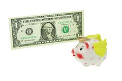 Flying piggy bank passing a dollar bill Royalty Free Stock Photos
