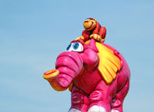 Flying pink elephant fairground ride Stock Photography