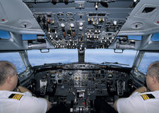 Flying the plane. In the cockpit with two pilots - and they are twins!  Not really Stock Photography