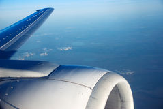 Flying on a plane. View from an airplane wing Royalty Free Stock Image