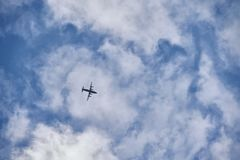 Flying plane in the blue sky royalty free stock image