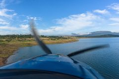Flying Plane Low Dam Waters Shoreline Stock Photo