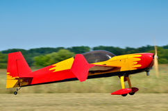 Flying the plane performs aerobatics in the sky Stock Photos