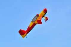 Flying the plane performs aerobatics in the sky Stock Images