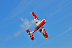 Flying the plane performs aerobatics in the sky Royalty Free Stock Images