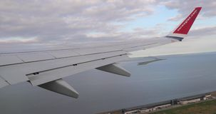 Flying on a plane, take off view stock video footage