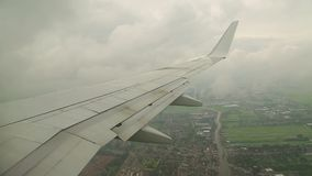 Flying on a plane. View from plane window during approach and a banking turn stock video