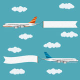 Flying planes with banners. Stock Photos