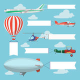 Flying planes, helicopter and airship pulling advertising banner. Flying planes pulling advertising banners. Helicopter, airplanes and airship with vertical and Royalty Free Stock Image