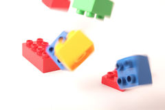 Flying plastic blocks Stock Photos
