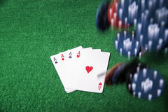Flying poker chips on green table royalty free stock photo