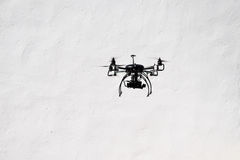 Flying quadrocopter drone with the camera Royalty Free Stock Photography