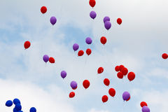 Flying red and blue balloons Royalty Free Stock Image