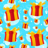 Flying red presents. Seamless pattern with Flying presents on a blue background Royalty Free Stock Photography
