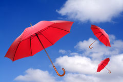 Flying red umbrellas Royalty Free Stock Photo