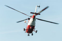 Flying rescue helicopter Stock Photo