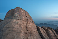 Flying Rock at dawn on the summit of Tai Shan, Shandong Province, China. TAISHAN, CHINA - JAN 2, 2014 - Flying Rock at dawn on the summit of Tai Shan, Shandong Royalty Free Stock Photos