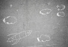 Flying rocket. Background image with flying drawn rocket on cement wall stock illustration