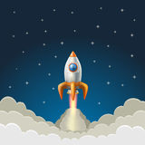 Flying rocket on a starry blue background Royalty Free Stock Photo