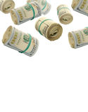 Flying Rolls Of One Hundred Dollar Bills. Abstract money background Stock Photos