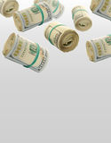 Flying Rolls Of One Hundred Dollar Bills. Abstract money background Stock Images