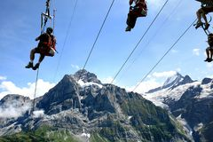 Flying on the rope in the Swiss Mountains Stock Image